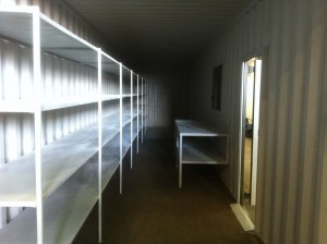 40ft Container fitted with shelving and bench with windows and normal door.